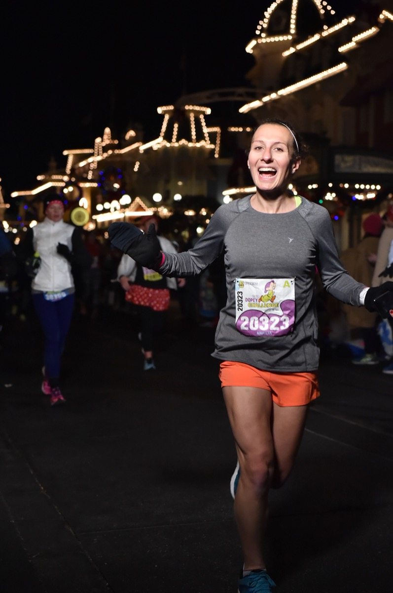 Amelia running on Main Street USA