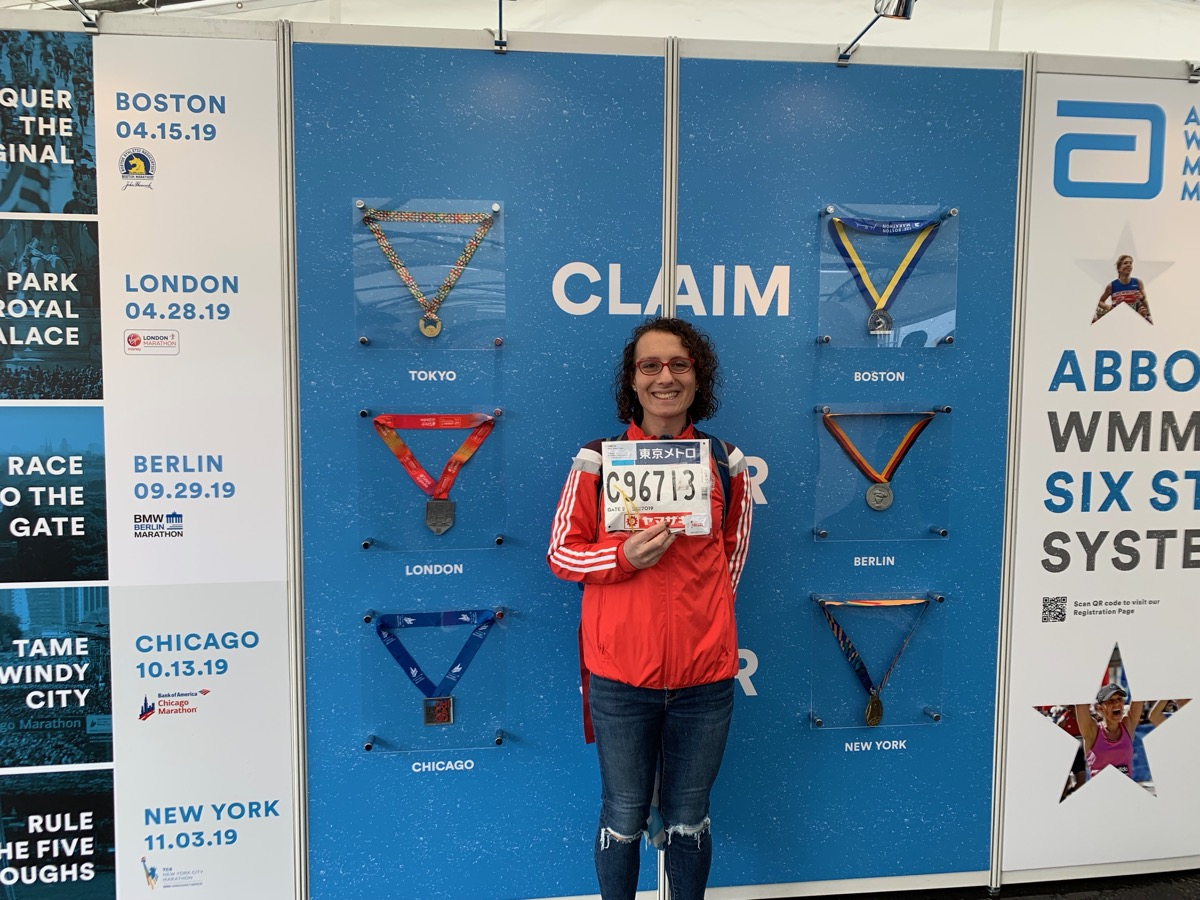 Amelia in front of World Marathon Majors display