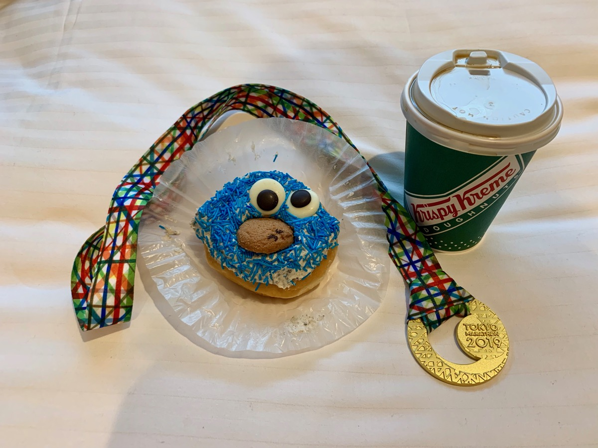 Race medal and Krispy Kreme